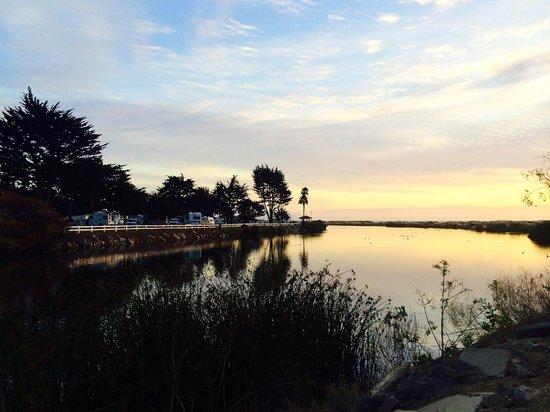 Pismo Coast Village RV Resort: Beautiful sunset at Pismo-RV park to the left