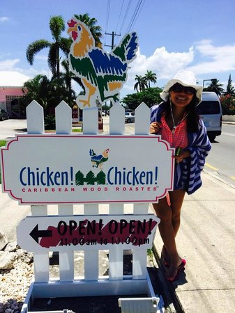Chicken! Chicken! Caribbean Wood Roasted: The sign across the street from the beach and the Royal Palms