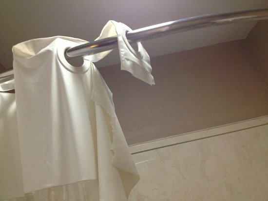 Days Inn & Suites Starkville : Torn shower curtain.