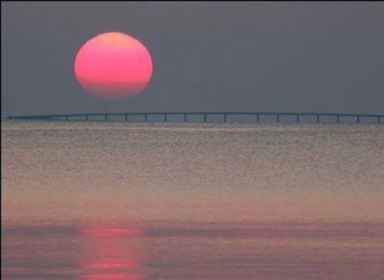 Navarra, FL: Sunrise over Navarre Beach Bridge