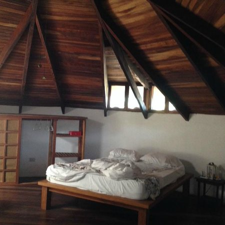 Hotel Mamiri : View of the main bed in the upstairs of the apartment.  This room is large and has several beds.