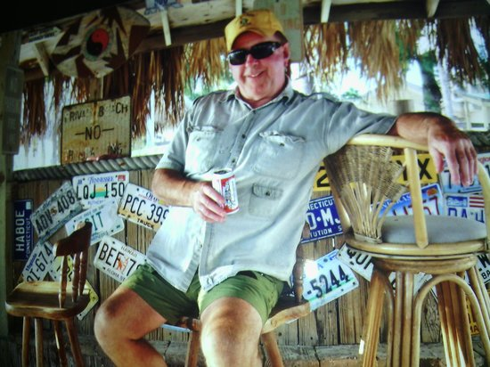 Cedar Cove Resort & Cottages: Navy Dad chilling in the tiki hut
