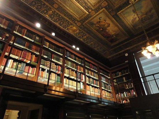 The Morgan Library & Museum: rare books line the upper level library walls