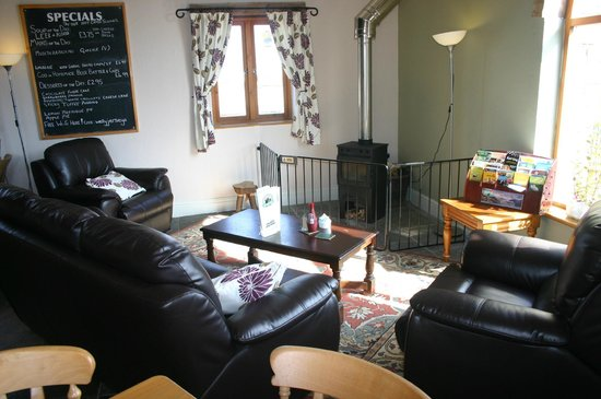 Wellington Farm Cafe & Tearooms: Our new cosy corner with wood burner and sofa area