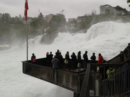 Rhine Falls : viewing platform, inches above the rushing waters