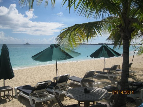 The Azure Hotel: view of the beach & lounge chairs.