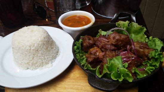 Vaca Brava : Pork tips with beans and rice.