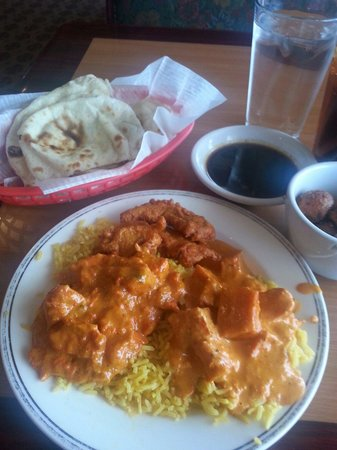 Yak and Yeti Restaurant: At the top is naan(bread served w/meal). On the plate is chicken tikka masala, sweet potato masa