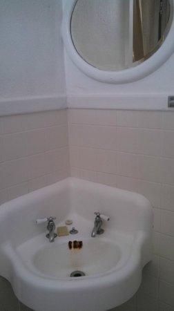 The Hotel Jacaranda: Hotel Jac bathroom sink and mirror