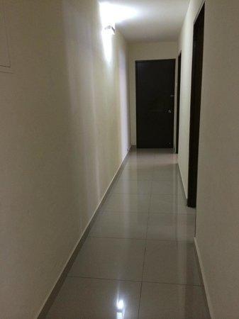 Fahrenheit Suites : Kinda dark hallway with the other locked door