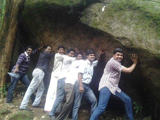 Thommankuthu Falls : A heavy rock pose