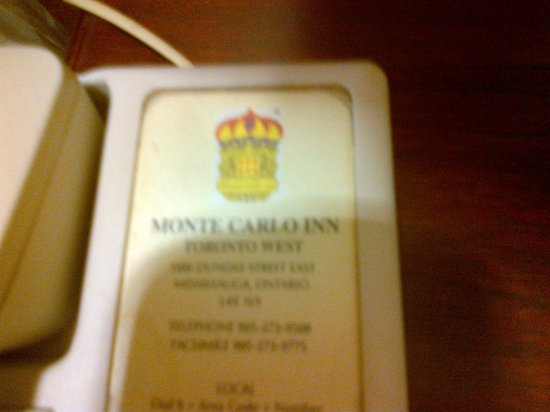 Monte Carlo Inn Toronto West Suites: Pic of the phone beside the bed-Filthy