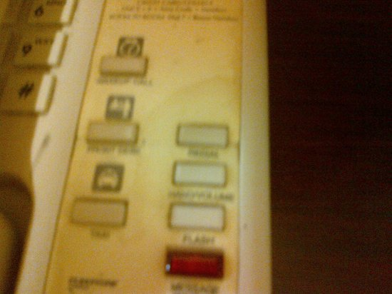 Monte Carlo Inn Toronto West Suites: Filthy Dirty Phone on desk