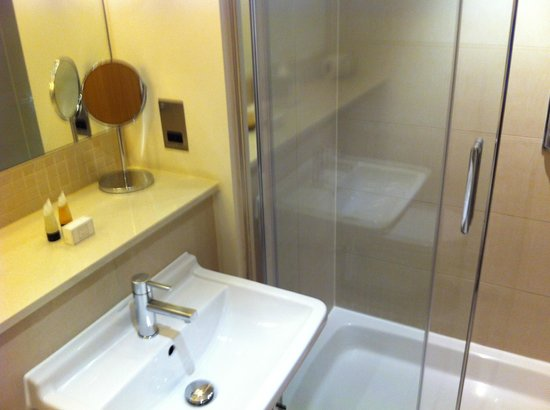 The Nadler Kensington: Bathroom with walk-in shower and a nice shelf to put all toiletries!