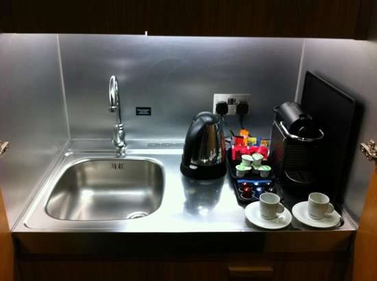 The Nadler Kensington: Small kitchenette area with fridge, kettle, sink, microwave and nespresso machine and capsules