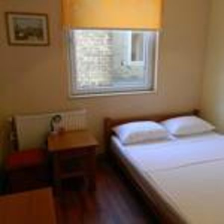 Rooms Centre: Twin room which has LCD TV, air conditioner, heating, desk with chair and wardrobe.