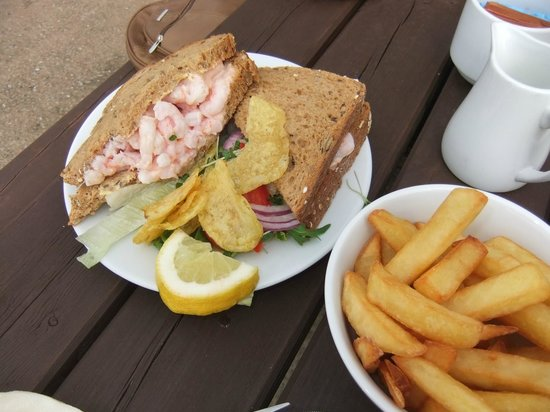 Bigbury-on-Sea Beach: A hugh prawn sandwich with a salad, crisps and bowl of chips. To die for, Bay View Cafe, Bigbury