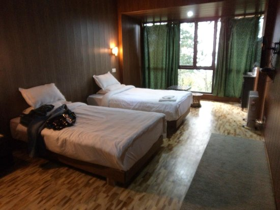 The Barfung Retreat: lovely bed and wooden decor with the picture window