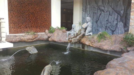 Coron Westown Resort: Fish pond near the reception area