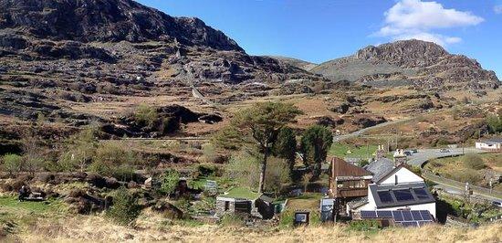 Bryn Elltyd eco Guest House: Bryn Elltyd on the right with solar panels etc