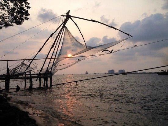 Chinese Fishing Nets: Redes chinas Kochi con puesta de sol