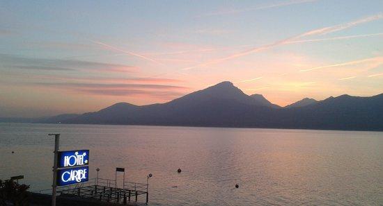 Hotel Caribe: Balcony Vire Sunset on Lake Garda