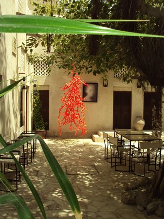 XVA Art Hotel: the art in the courtyard, our room doors to the left