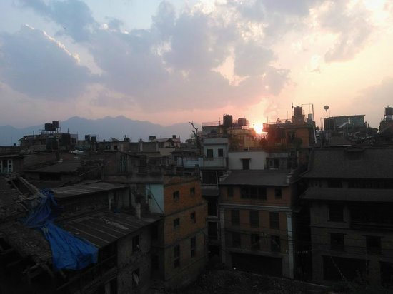 Traditional Homes - SWOTHA: sunset over the rooftops from roof terrace