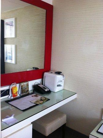 Hard Rock Hotel Goa: The coffee machine,mirror and the internet set up