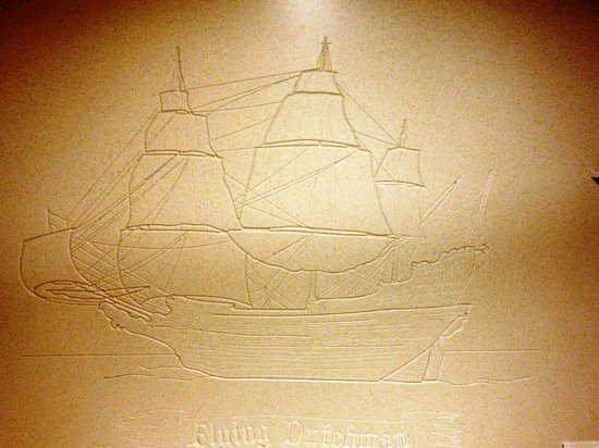 """Disney's Caribbean Beach Resort: The """"Flying Dutchman"""" carved into our shower wall"""