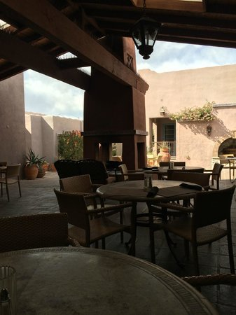 Lodge on the Desert: outdoor fireplace near restaurant and bar