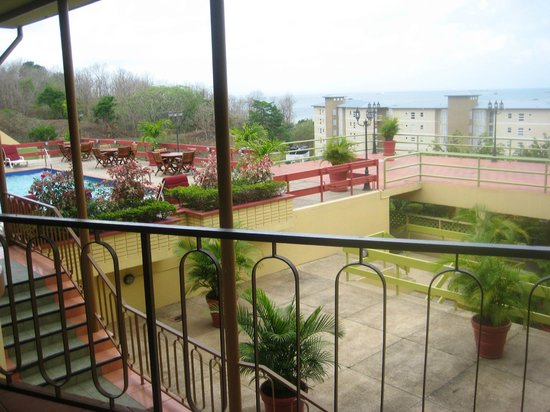 Cara Suites - Pointe a Pierre: View of the pool and Cara Courts