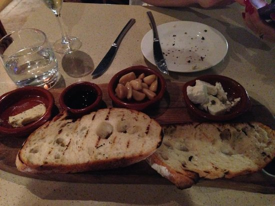 Bistro Alegria : Sour Dough with flavoured butter, confit garlic, marinated fetta, olive oil and balsamic reducti