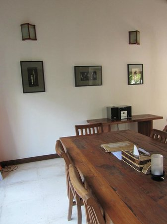 Kelapa Luxury Villas: old and worn dining tables and chairs