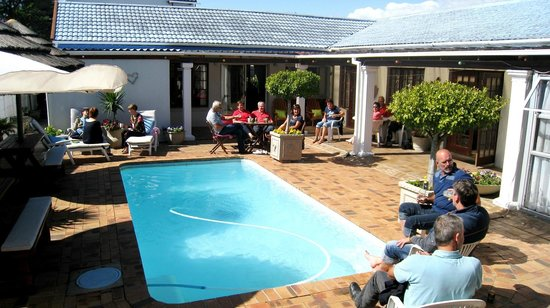 Dolphin Inn Guesthouse-Blouberg: Pool area is lovely area for guests to mingle and relax