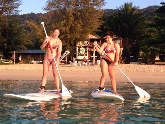 Tioman Cabana Bistro And Tour: Playing STAND UP PADDLE in front of   The Cabana by rental at Shamrock Watersport just next door