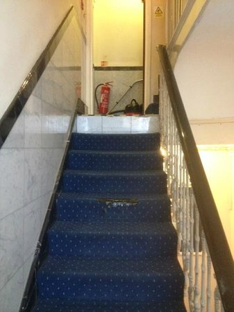 Whiteleaf Hotel: communal steps with tape keeping carpet in place