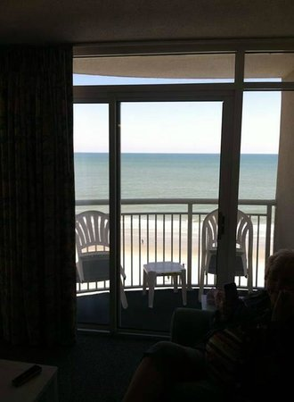 Atlantica Oceanfront Resort: View of the balcony and beach from inside the living room