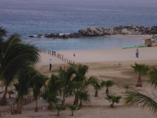 Paradisus Los Cabos: rough sandy area, palapa's not on water edge, small swimming area