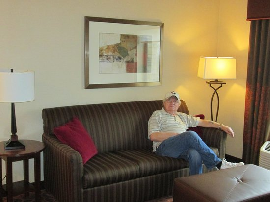 Hampton Inn & Suites Grand Forks: Couch that opens up into  bed with large ottoman