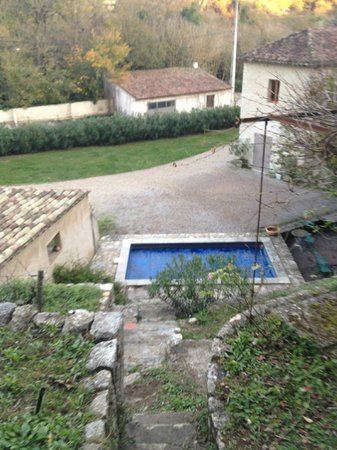 "Moulin Sainte Anne : View of the pool and main drive from the ""hanging gardens"" and grapevine trellis area."