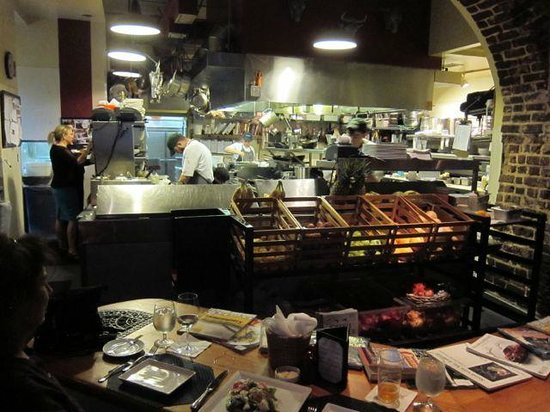 Slightly North of Broad : View of the kitchen from the Chef's Table in the foeground