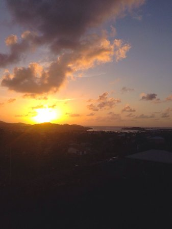 Caribbean Inn and Suites: A view of a beautiful sunset on St. John's from the top floor.
