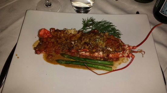 Finns' Table: Beautifully prepared local lobster - baked whole stuffed with herbs and sources of asparagus and