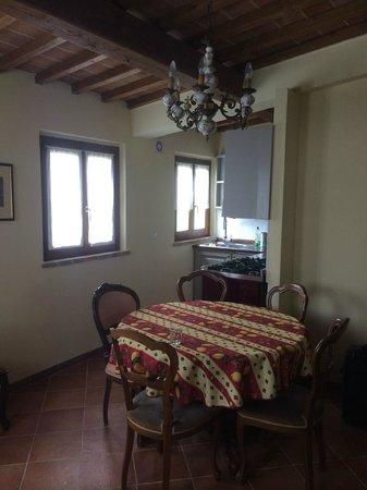 Al Giardino degli Etruschi: Table and chairs in sitting area, kitchen in background