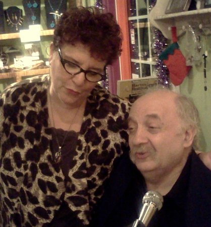 """Arts & Eats Restaurant and Gallery: Owner/Manager Donna Slawsky singing with Michael """"Sparky"""" Edelstein"""