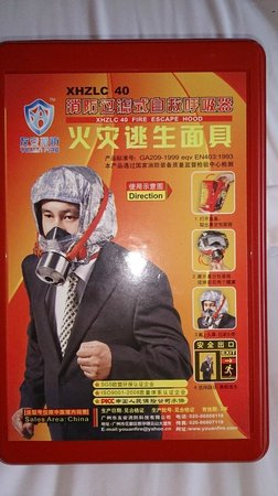 Pullman Guangzhou Baiyun Airport: Loved these emergency escape masks in the cupboard