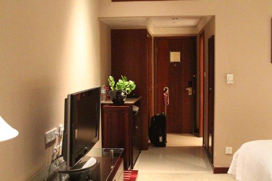 Hangzhou Xanadu Narada Hotel: Entry and desk area