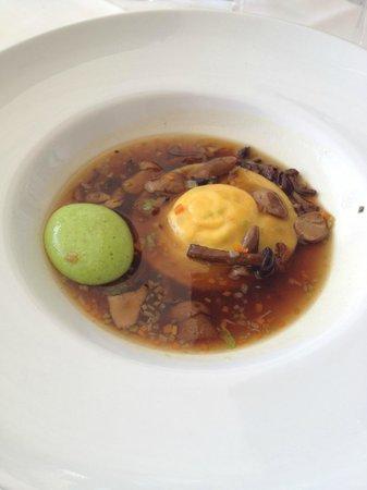 Euro: Delectable Mushroom Broth, Ravioli & Pea Surprise