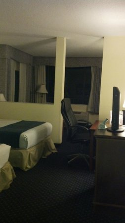 Best Western Cocoa Beach Hotel & Suites : beds/desk, couch and lounge area beyond half wall